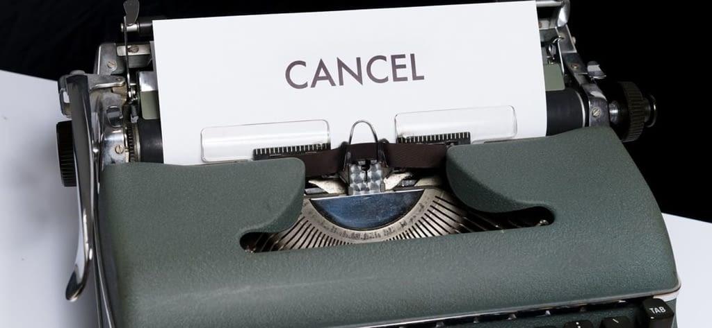 green and white typewriter on black textile